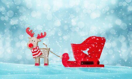 Photo pour Santa Claus deer and empty sleigh in snow. Cute wooden toy. Copy space above. - image libre de droit