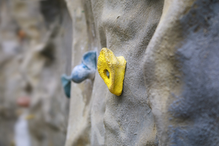 Artificial climbing wall with yellow grip