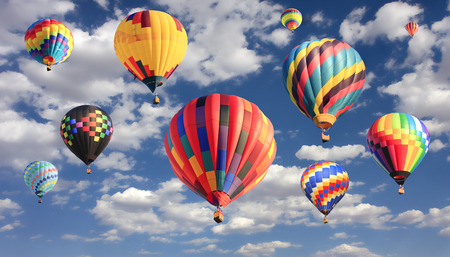 Multicolored hot air balloons flying