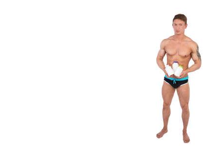 Photo pour Bodybuilding Supplements and muscular man. - image libre de droit