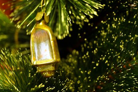 Photo pour Bright and shiny decorations for Christmas and New Year hang on a green spruce. Winter holidays. - image libre de droit