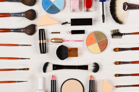 Various makeup products on white wooden backgroundの写真素材