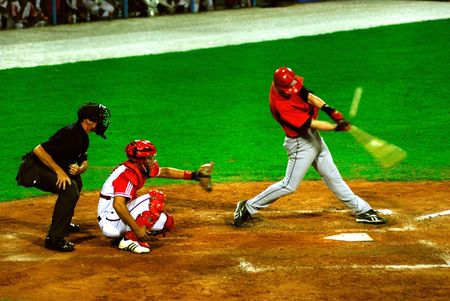 Game bettwen canada and cuba in the baseball worldcup 2009(5 september).Catching the ball was Ariel Pestano,the regular catcher in the game,(and of the cuban team)Cuba was the winner,5x1,のeditorial素材