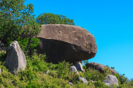 Big stone among savanna. Beautiful landscapes of Serengeti, Tanzania