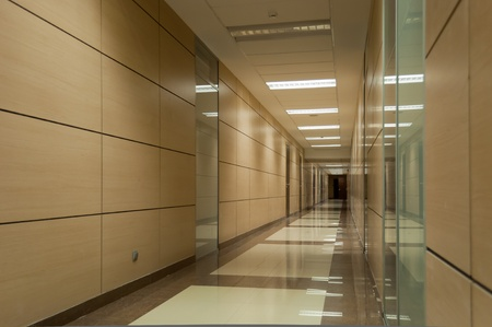 Long beige corridor in a modern office building