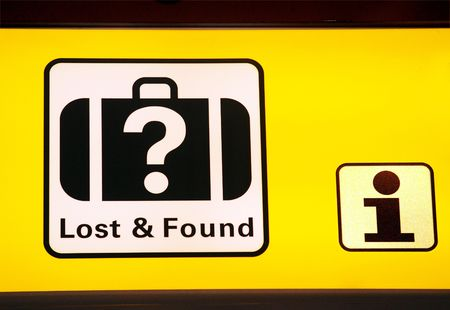 Sign in airport hall with direction to information and lost/ found
