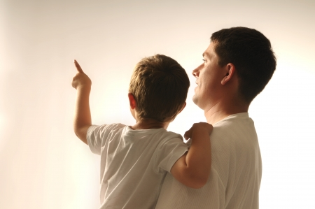 Picture of father and his son pointing at something