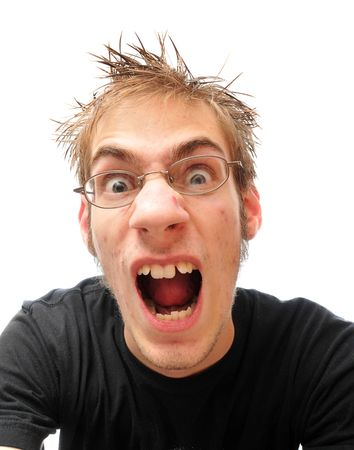 A young man screams, shouts, and yells in frustration, isolated on white.