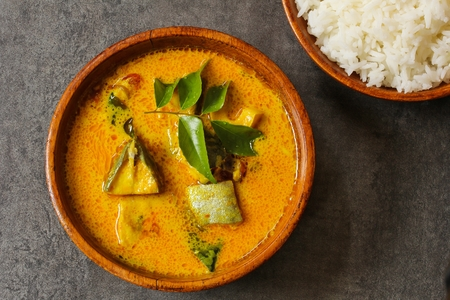 Photo for Spicy Indian Fish curry in coconut milk top view - Royalty Free Image