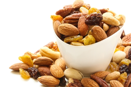 Assorted mix of dry fruits and Nuts almond,cashew, peanut,raisin and walnut in white bowl