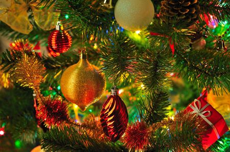 decorated Christmas fir tree with colorful lights close up
