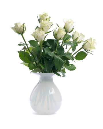 bunch of white roses in glass white vase isolated on white background