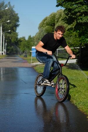 boy riding on street bmx