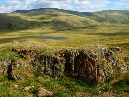 Lone lake in steppe, mountain Altai
