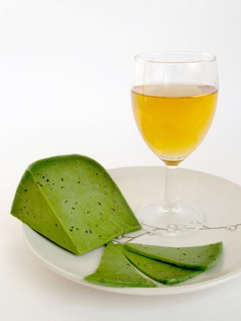 Green cheese and wine glass on a white background