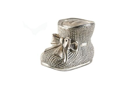 Photo pour Antique metal money box in the shape of a bootie with bow isolated on white background - image libre de droit