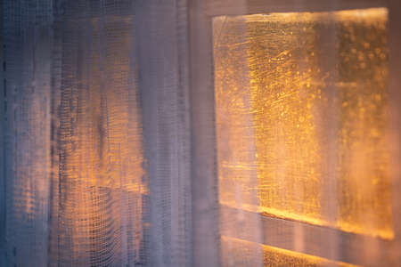 Photo pour Abstract photo of an old curtain lit with warn sunlight. - image libre de droit