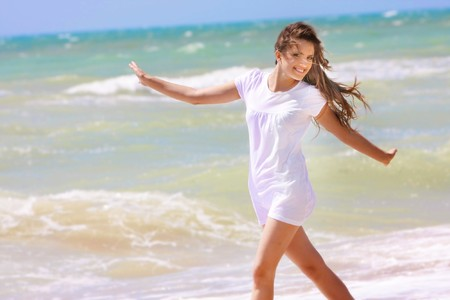 young happy girl on sea background