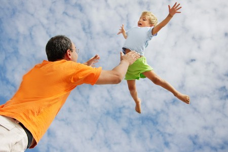 flying child on sky background