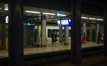 Passengers at Subway Platform in Amsterdam Schiphol Railway Station