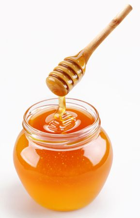 Full honey pot and honey stick