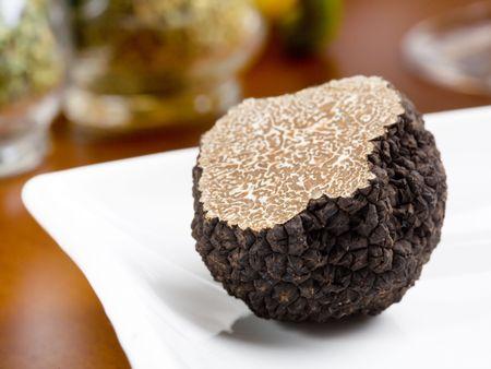 Photo pour Mushroom of truffle on a white dish - image libre de droit