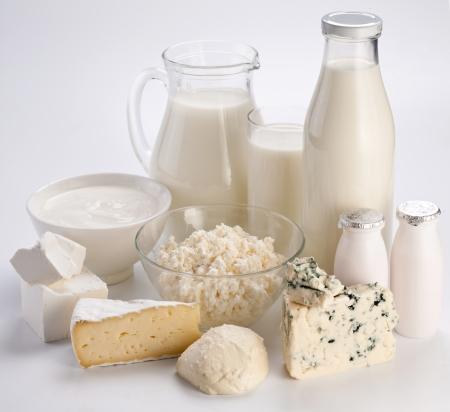 Different milk products: cheese cream, milk, yoghurt. On a white background.