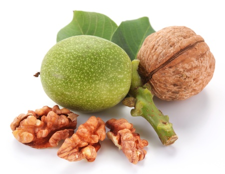 Green walnut; peeled walnut and its kernels. Isolated on a white background.