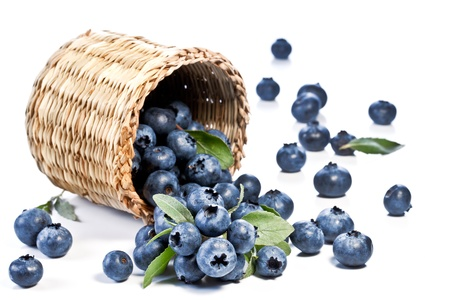 Blueberries fall of the basket. Image on white background.
