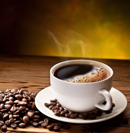 Photo pour Coffee cup and saucer on a wooden table. Dark background. - image libre de droit