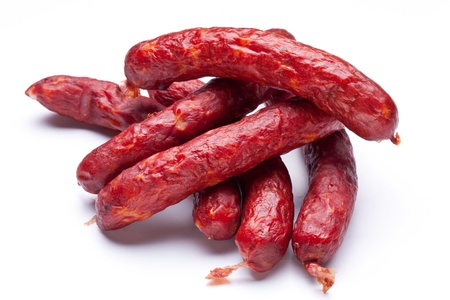 Smoked sausages on white background