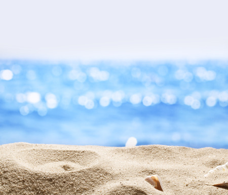 Foto de Sand with blurred sea background. File has clipping path for holes in the sand. You can insert the bottle or glass. - Imagen libre de derechos