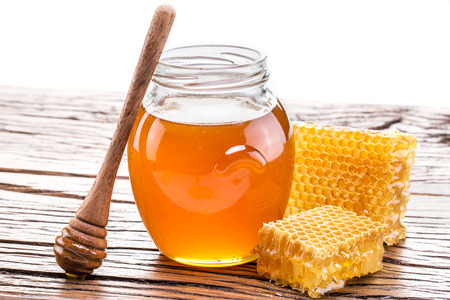 Honeycomb and pot of fresh honey.