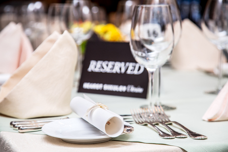Photo for Festival dinner setting and Reserved sign. - Royalty Free Image