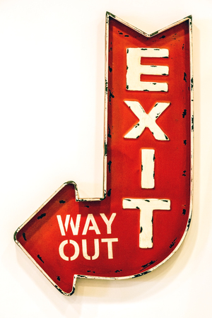 Exit sign. Red arrow sign on the white background.