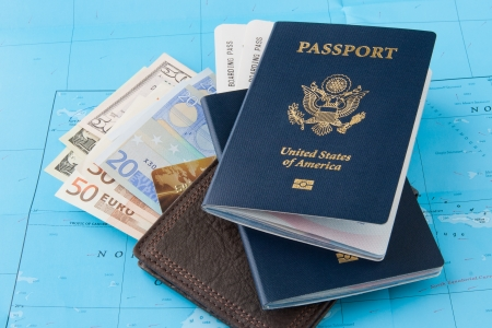 Passports and wallet with dollars, euro and credit card on a map background  Travel concept