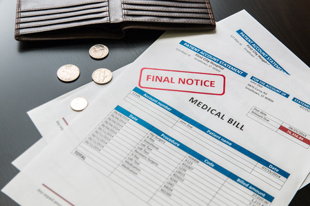 Photo pour Medical bill from the hospital, concept of rising medical cost, selective focus.  All data on the bill and form design are fictional, created specially for this concept. - image libre de droit