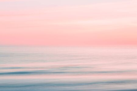 Photo for Abstract sunrise sky and  ocean nature background with blurred panning motion. - Royalty Free Image