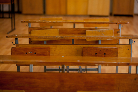Photo for Old Vintage Wooden School Desks in Classroom. - Royalty Free Image