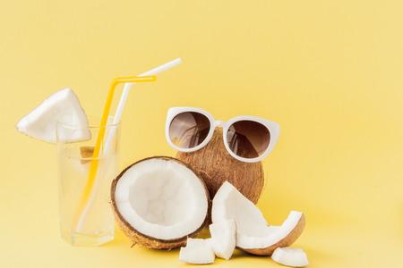 Foto de Fresh Coconut cocktail with a straws on yellow background, copy space. - Imagen libre de derechos