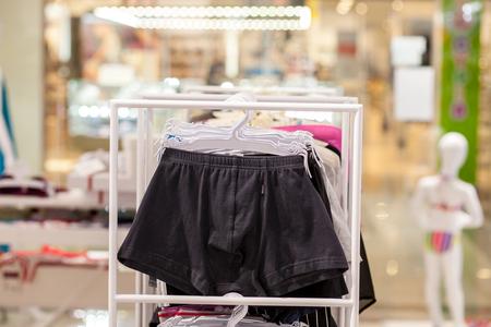 Foto de Men's underwear in a boutique. Advertise, Sale and Fashion concept. - Imagen libre de derechos