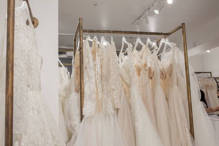 Photo for Assortment of dresses hanging on a hanger on the background studio. Fashion wedding trends. Interior of wedding shop. - Royalty Free Image