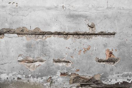 Foto de Cracked concrete grey wall covered with gray cement texture as background can be used in design. Dirty concrete texture with cracks and holes - Imagen libre de derechos