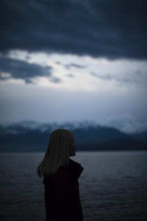 woman alone on lake