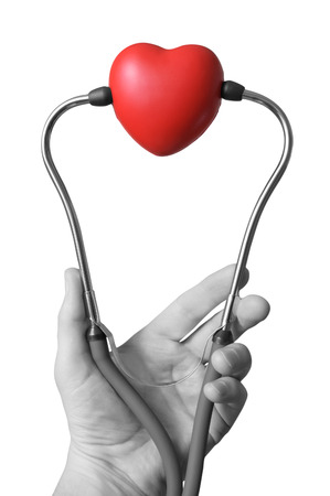 Male hand holding a red heart and stethoscope