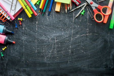 Photo for Border of School supplies on a chalkboard background. Free space - Royalty Free Image