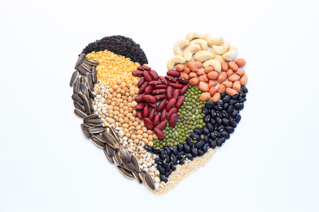 Heart made of  nuts, isolated on white background.