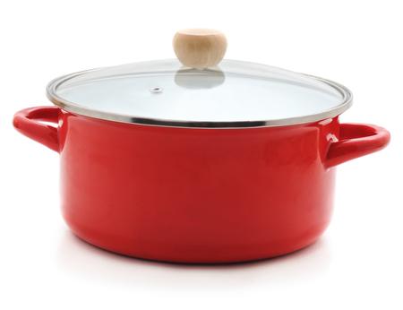Foto de Enamelled red pan isolated on a white background. - Imagen libre de derechos