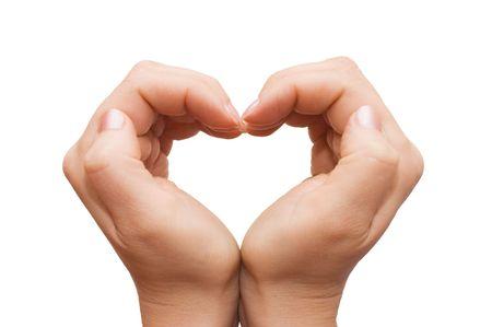 Photo pour hands forming a heart on white background  - image libre de droit