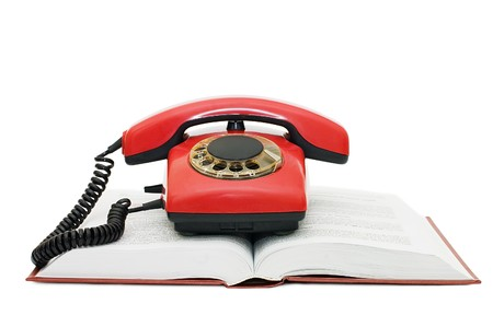 Red phone on the book isolated